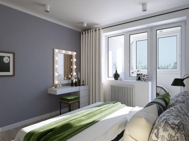 Quarto fresco em cinza e branco com detalhes em verde graças à roupa de cama.